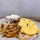 Creamy mushrooms with sausages on sourdough