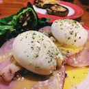 Egg Benedict - Poached eggs with bacon and honey ham on english muffin topped with hollandaise sauce.