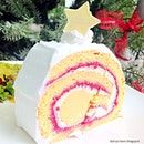 White Lychee Christmas, an orange flavored traditional Swiss roll swirled with sweet raspberry jam and a rose cream centre