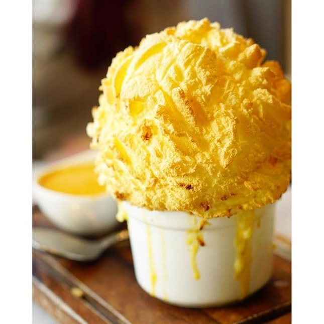 Pillowy Crab Soufflé paired with a rich Lobster brandy sauce from #AudreyCafeDesFleurs.