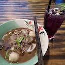 Beef boat noodles with butterfly pea drink.