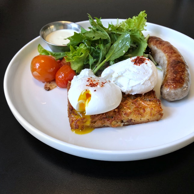 Grilled German Bratwurst w/ A Pair Of Poached Eggs $19