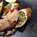 Pork-Stuffed Calamari w/ Squid Ink Sauce