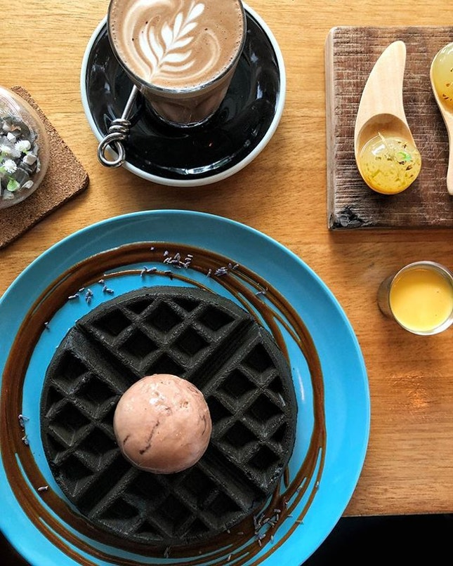 A date with B and having our favourites on the table 💕 -Charcoal waffles with Smoked Chocolate Ice cream and Salted Egg sauce -Lime Spheres -Flat White