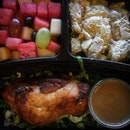Roast Chicken Breast with Potato Salad and Fresh Cut Fruits