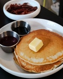 Good ol' Classic Pancakes with Butter and Maple Syrup, Grilled Bacon