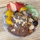 Large Cacao Bliss Açaí Bowl = Granola + Cacao Nibs + Almond Flakes + Fruits (sans Bananas) over Chia Seeds Parfait.