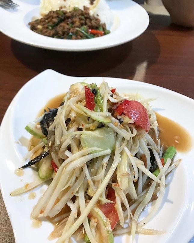 """""""Fish Crab"""" Green Papaya Salad and Pad Krapow - delicious Thai food from Nana Original Thai Food at Far East Plaza 🤤 ."""