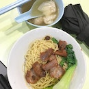 A small bowl of wanton mee but oh so delicious and fresh egg noodles .