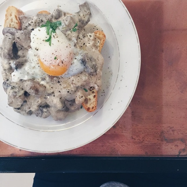 Huuuuuge amount of creamy truffled mushrooms with Brie and gruyere (cheeeeeeeeese!!) and sous vide egg on crispy ciabatta slice; so creamy so rich so filling  #VSCOcam #vscosg #vscofood #food52 #sgcafefood #sgeats #sgcafe #sgfood #burpple