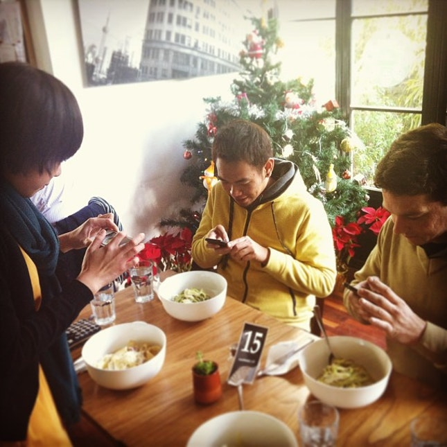 Picture of Asians taking picture of food. Oh and Caucasian! #food #instadaily #shanghai