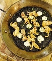 Squid ink paella pasta with crispy calamares @1_una ?