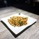 Crispy fried squid, caramelised in spicy fish sauce and curry leaves!