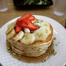 Pancakes with strawberries, bananas and maple syrup eaten at @_thebravery_ .