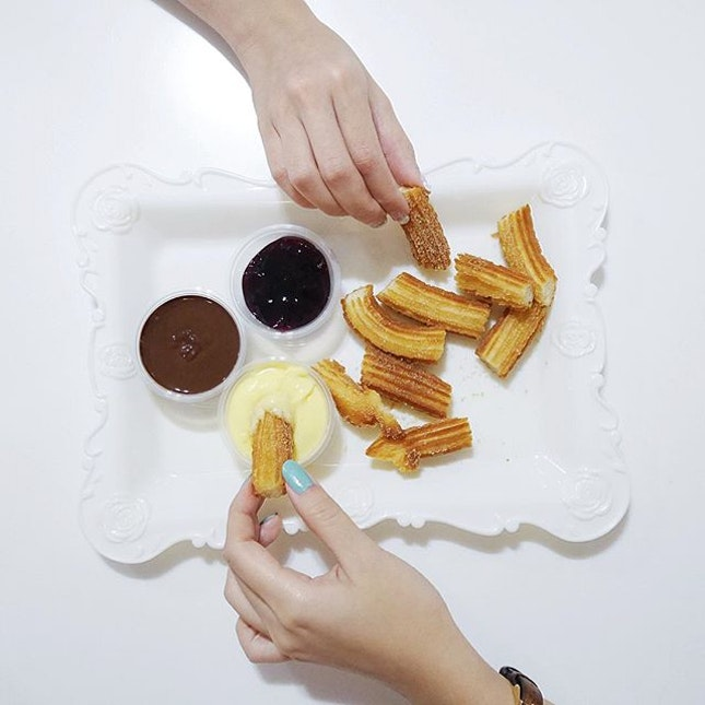 Churros with 1 Dip •SGD 5•  Piping hot crispy golden brown churros dusted with sugar cinnamon, that were freshly fried upon order, with a choice of blueberry, dark chocolate or milk custard dip.