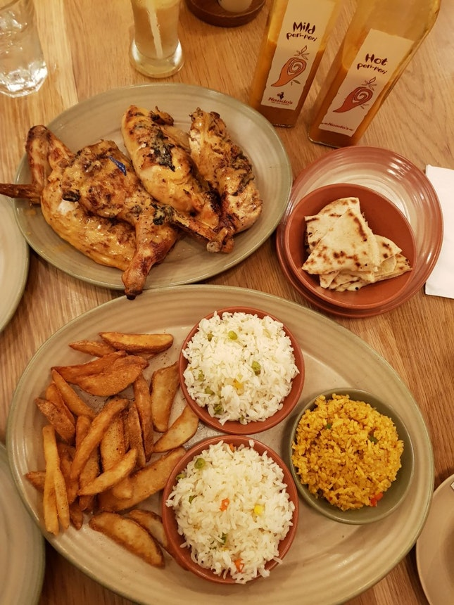 Whole Chicken + 4 Regular Sides (2 Mediterranean Rice, 1 Spicy Rice and Peri-Peri Wedges) + Cheesy Toasted Pita Bread
