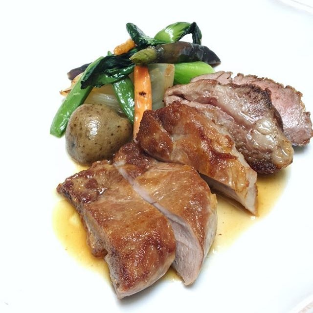 Pluma Iberica, a deliciously fatty cut of a pig's shoulder, served with a side of greens.