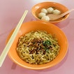 Fishball Noodles Dry from Xin Lu Teochew Fishball Noodle  The noodles here are springy and soaked in a small layer of soup that goes perfectly with the savoury sweet sauce when tossed together!