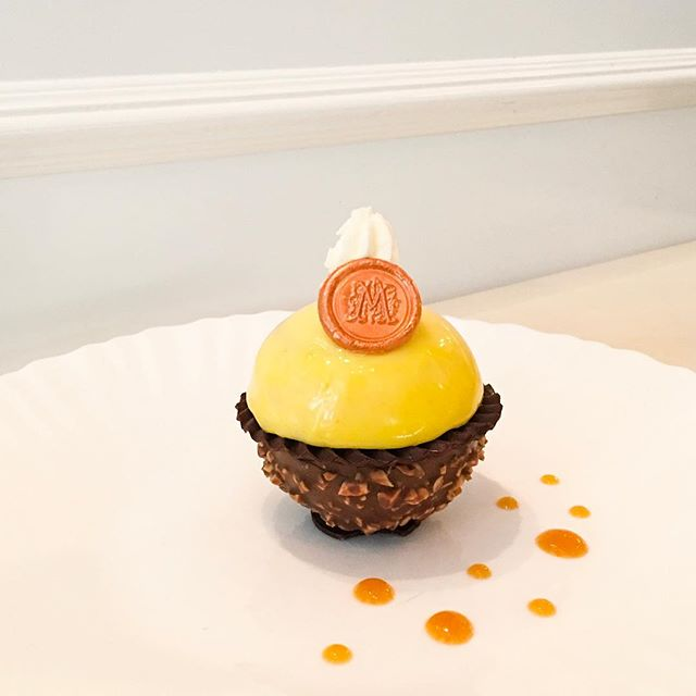 E.Ti  One of the summer confections available for their Summer 1982 creations, the namesake of the dessert was inspired from a character of a blockbuster movie of that time, which consist of a organic almond chocolate shell containing a cold-dripped espresso coffee mousse and nut sponge cake, covered with a thin piece of dark chocolate and Spanish mandarin orange cream, topped off with chantilly cream!