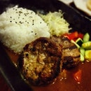 Beef and pork hamburger patties with Japanese curry.
