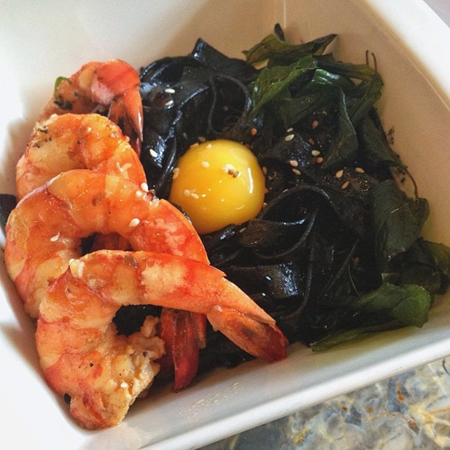 Squid ink fettuccini with sautéed prawns...and an egg yolk for good measure.