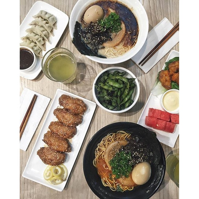 Flatlay at Kanshoku Ramen, offering 6 different types of ramen as well as side dishes such as the black truffle edamame.