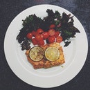 The complete dish for dinner - oven-baked paprika salmon with line and a sprinkle of rosemary.