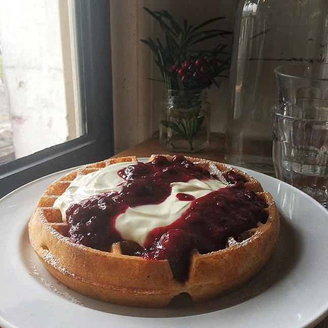 Buddies reunion at Stranger's Reunion over buttermilk waffle with greek yoghurt & mixed berries compote.