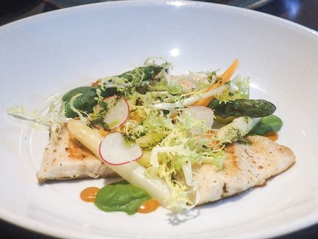 Seabass with vegetables and dollops of saffron.