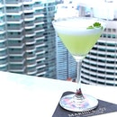Cilantro Sour and Scottish Martini, on the 57th floor with a view of the famous Petronas Tower.
