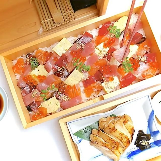 Okamochi Bara Chirashi-Sushi served in a box with drawers from Ryu's Japanese Restaurant.