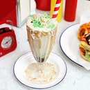 Chendol Milk Shake from @capitolmilkbar prepared with red bean, pandan jelly, gula Melaka and coconut flakes.