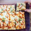 Cheesy #FrenchPizza aka #TartFlambee at #ImmanuelFrenchKitchen.