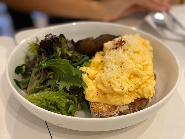 Scrambled Eggs on Sourdough With Grilled Portobello Mushroom and Mesclun Salad