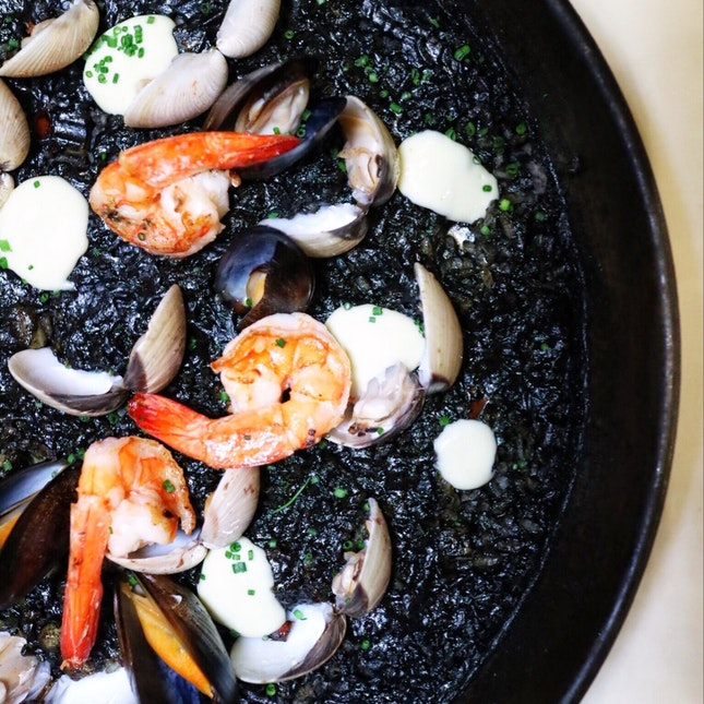 Arroz Negro ($52/$72), squid ink paella with fresh cuttlefish, prawns and clams, served with that same aioli sauce again, was the lesser evil as compared to the chorizo paella.
