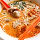 A bowl of laksa with sliced beef is comfort food for the soul.