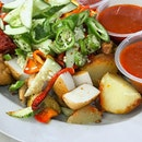 The journey to the West brings us to Ayer Rajah Food Centre which houses a stall opened by a young hawker selling Indian rojak.