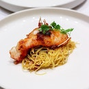 Pictured is the pan-seared lobster with XO sauce and served with yuzu noodles, a dish represented by the Crystal Jade Palace for the Crystal Jade's Chinese New Year 2019 media tasting menu.