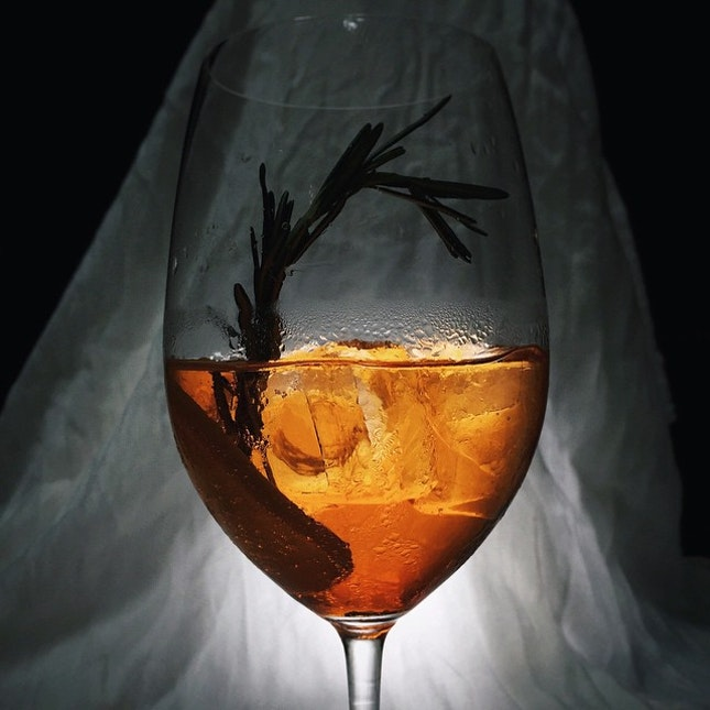 Rosemary Spritz - Rosemary infused Aperol, orange curacao and seltzer water.