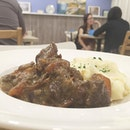 Boeuf Bourguignon ($9) Beef stewed in red wine, served with mash.