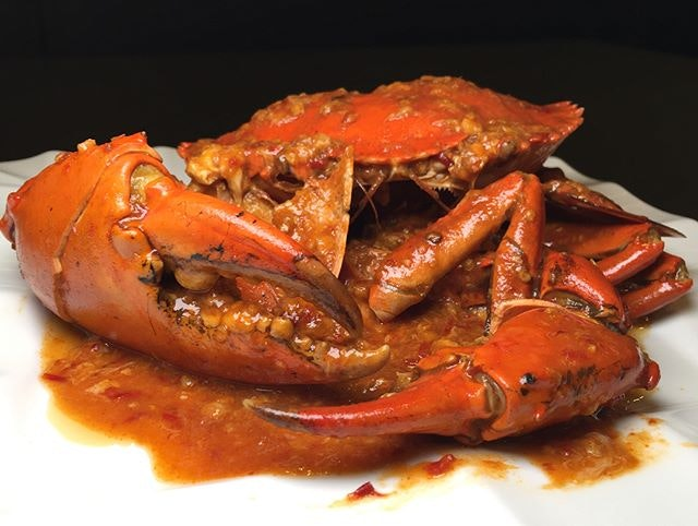 Last night's dinner  First time having chilli crab 🦀 with live crab 🦀 from the display shelves in an Indian restaurant.
