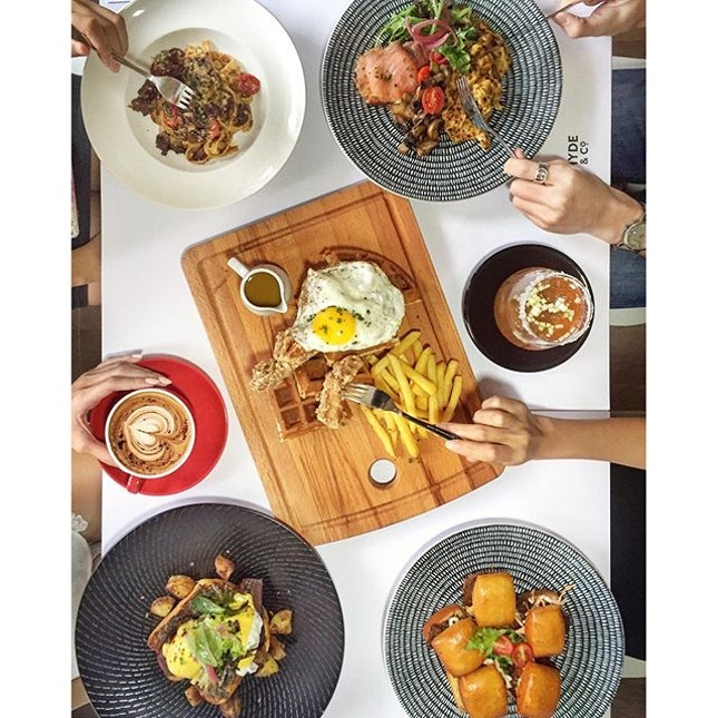 [bugis] revamped brunch at @hydeandco  prawn paste chicken waffle with the promiscuous egg, beef rendang pasta and pulled beef man tou.