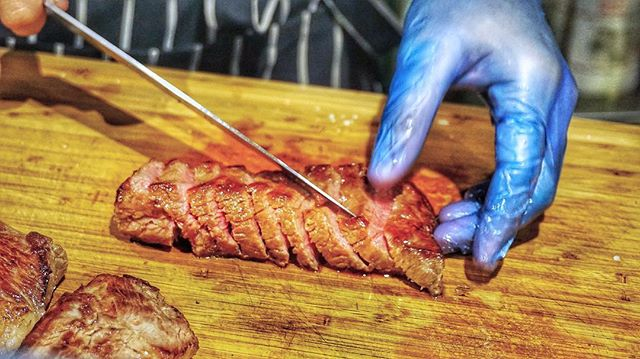 It's in the hands, the way he lovingly handles this steak.