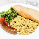 Truffle Scrambled Eggs with British Pork Sausage, Salad and Toast [$14.90]