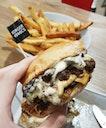 Deluxe Burger ($6.50) and Cajun Fries ($2)
