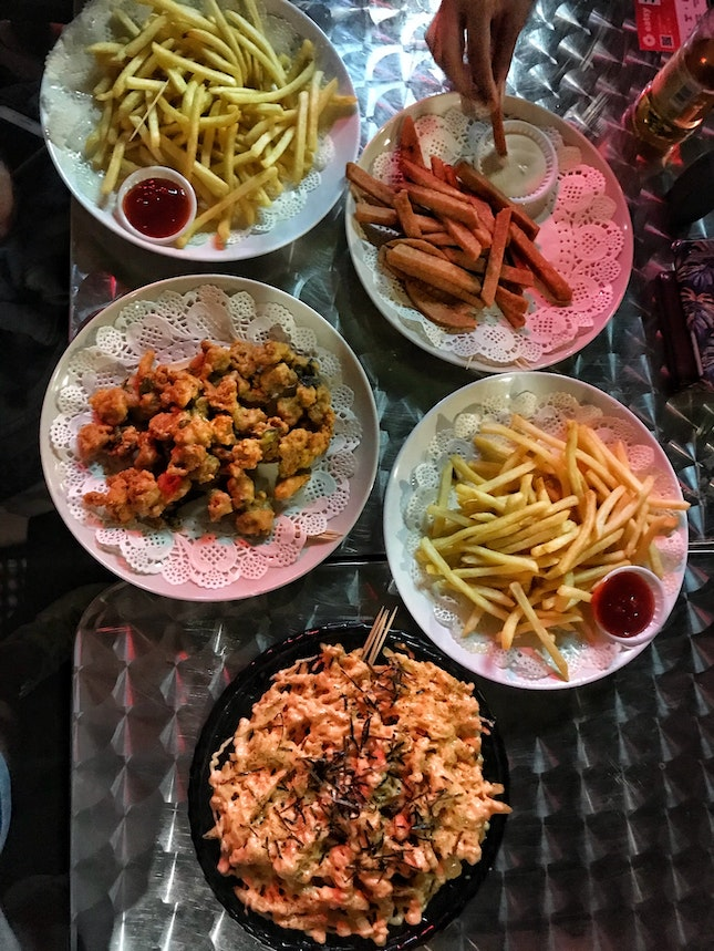 Salted Egg Popcorn Chicken ($12), Mentaiko Fries ($10), Truffle Fries ($10), Spam Fries ($8)