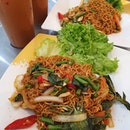 Phad ki mao mama with seafood ($6 each) & Iced thai milk tea ($3 each) - burpple beyond: $9!