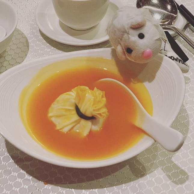 Bird nest soup but it is wrapped in egg wrap with carrot soup encircling it - a delightful and yummy dish that screams 'eat me eat me'!