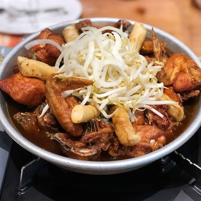 [Jjimdak-$32.90]  The chicken in this dish is fried before being dumped in the pot of brown sauce which also contained a generous amount of jjolmyeon (korean wheat noodles), tteokbokki and assorted vegetables.