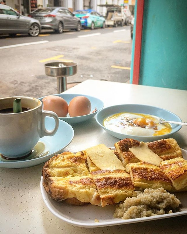 10am post-call but #startyourdayright with my favourite perk-me-up Nanyang style breakfast of all time: smooth gao kopi, french toast grilled over charcoal stove with yummilicious old-school kaya and salted butter, and a couple of good old soft boiled eggs with a dash of black soya sauce & pepper ♥️#mylifeiscomplete #woesofbeingoncall #burpple